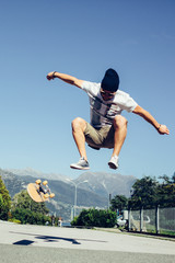 Guy jumping with skate