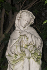 Sculpture of woman in tropical garden, art expression in exterior guatemala.