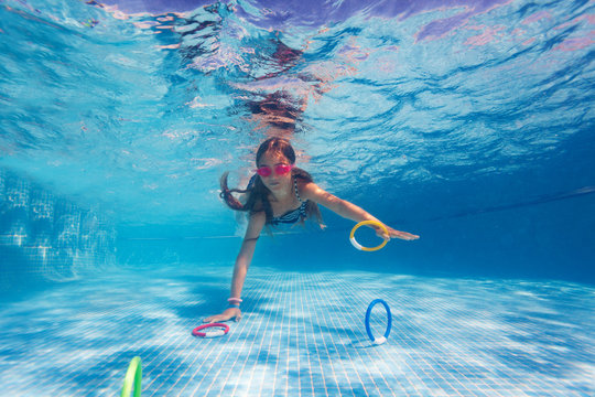 Girl exercising during underwater swimming lesson