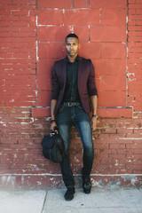 Black businessman portrait in urban area