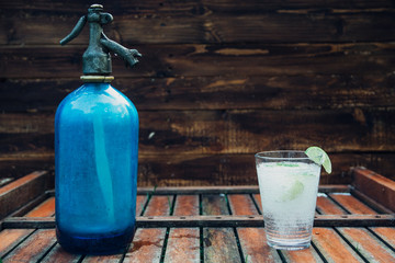 Old Seltzer water aerator bottle and lemonade glass