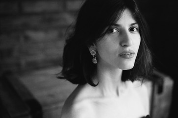 Portrait of the beautiful woman  looking at camera at camera in black and white
