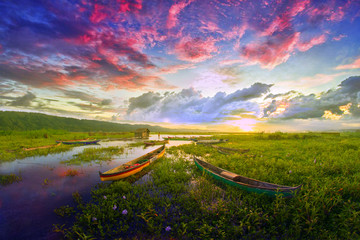 Colourful lake with two boats