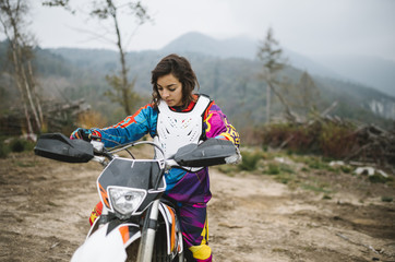 Young woman with her motorcycle