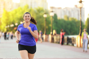 Keuken foto achterwand Jogging Overweight young woman jogging in the street. Weight loss concept