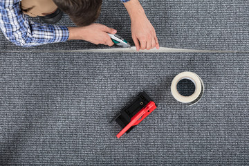 Carpenter Laying Carpet
