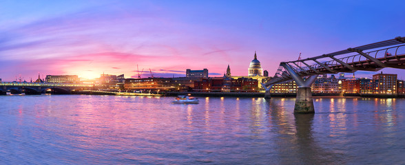 Illuminated London, view over Thames river from South Bank Ennbankment at sunset Wall mural