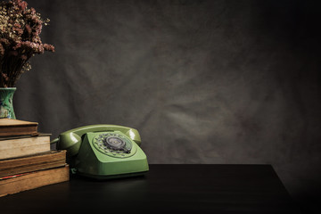 Vintage old phone on the table , still life