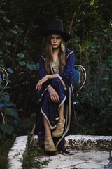 Woman wearing '70's style two piece Morrocan dress and a hat