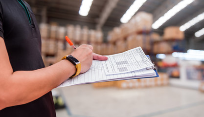 worker in factory, checklist at the warehouse