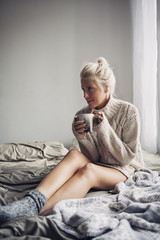 Beautiful Woman Drinking Hot Coffee in Bed
