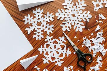 Making paper snowflake crafts.