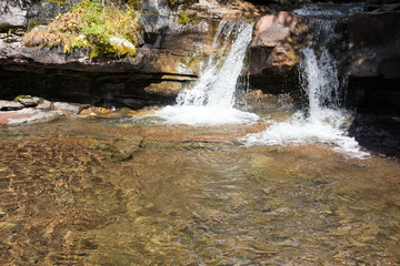 Two small waterfalls into a clear pool on Lime Creek near Silverton, Colorado