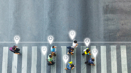 concept art of person icon with world social network connecting of one man walk converse,  the busy city crowd move to pedestrian crosswalk on businees traffric road (Aerial photo, top view)