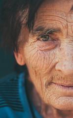 Closeup left part portrait of senior woman