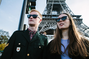 Two people in front of the Eiffel Tower in Paris