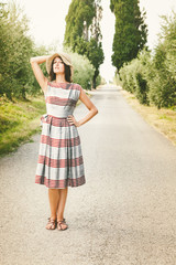 Beautiful Woman with Vintage Dress in the Italian Countryside