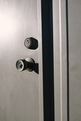 Close up door handle and lock on building exterior