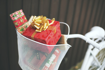 Christmas gifts  in a bicycle basket