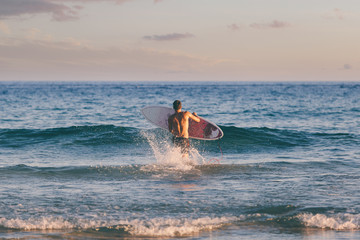 Surfer Preparing to Take the Waves