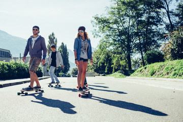 Group of friends have fun skateboarding