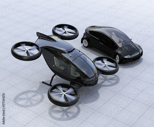 Self-driving car and passenger drone parking on the ground