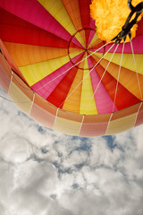looking up into a hot air balloon canopy with a flame burst