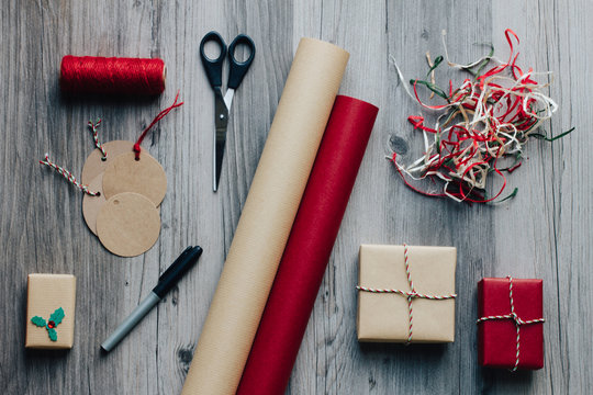 Christmas presents and wrapping tools arrangement from above