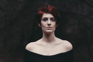 Dark Portrait of Woman in Autumn Forest
