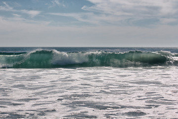 Nice wave at the beach on sunny day