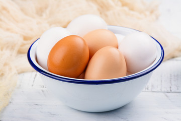 Hen eggs in a bowl. Rustic style