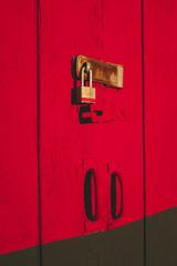 Padlock on brightly colored building door