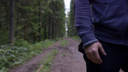 Fototapeta Athlete on road through forest. Athletic man on road through forest. Athletic man standing on trail through autumn forest