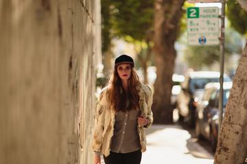 Trendy young woman walks down the San Francisco sidewalks