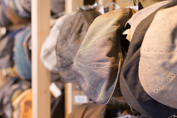 newboys cap hats hanging on the wall in mall