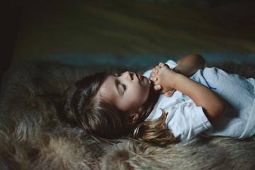 Little girl with hands folded in prayer