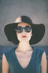 trendy young woman wearing hat