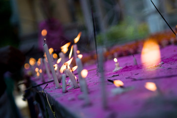 Traditional lamps and candles lit for worshipping in India