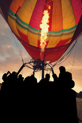silhouette of people on a hot air balloon
