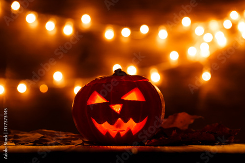 Photo of halloween pumpkin cut in shape of face