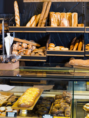 bakery shop with assortment of bread on shelves