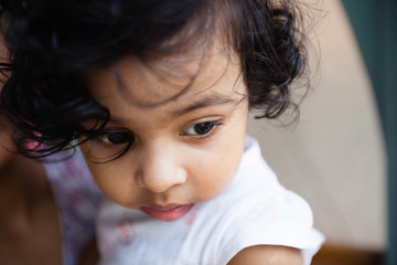 Close up portrait of toddler in sad mood