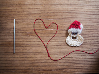 Image of I love Santa spelled out in yarn and a crochet hook