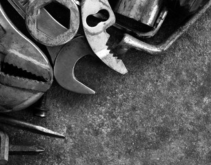many tool on cement ground in black and white photography