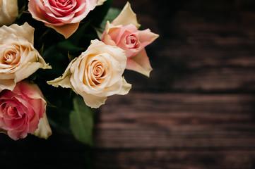 Arrangement of Roses against a dark Backdrop