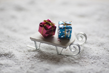 Miniature sledge and Christmas gifts