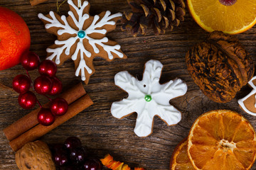 christmas gingerbread snowflake cookie with otanges, spices and decorations