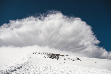 Stormy clouds overhang over the snow-capped mountain Elbrus