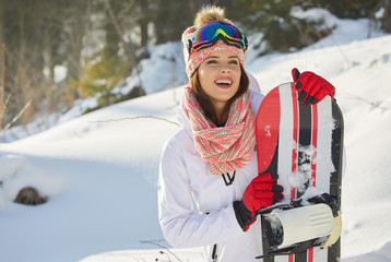 Sexy snowboarder woman outdoors. Winter resort