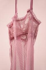 pastel pink lace underwear on pink background